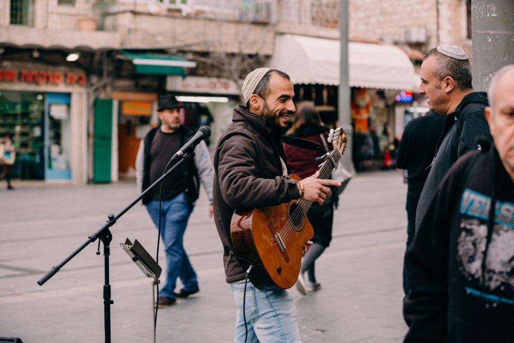 israeli playing music on a street corner