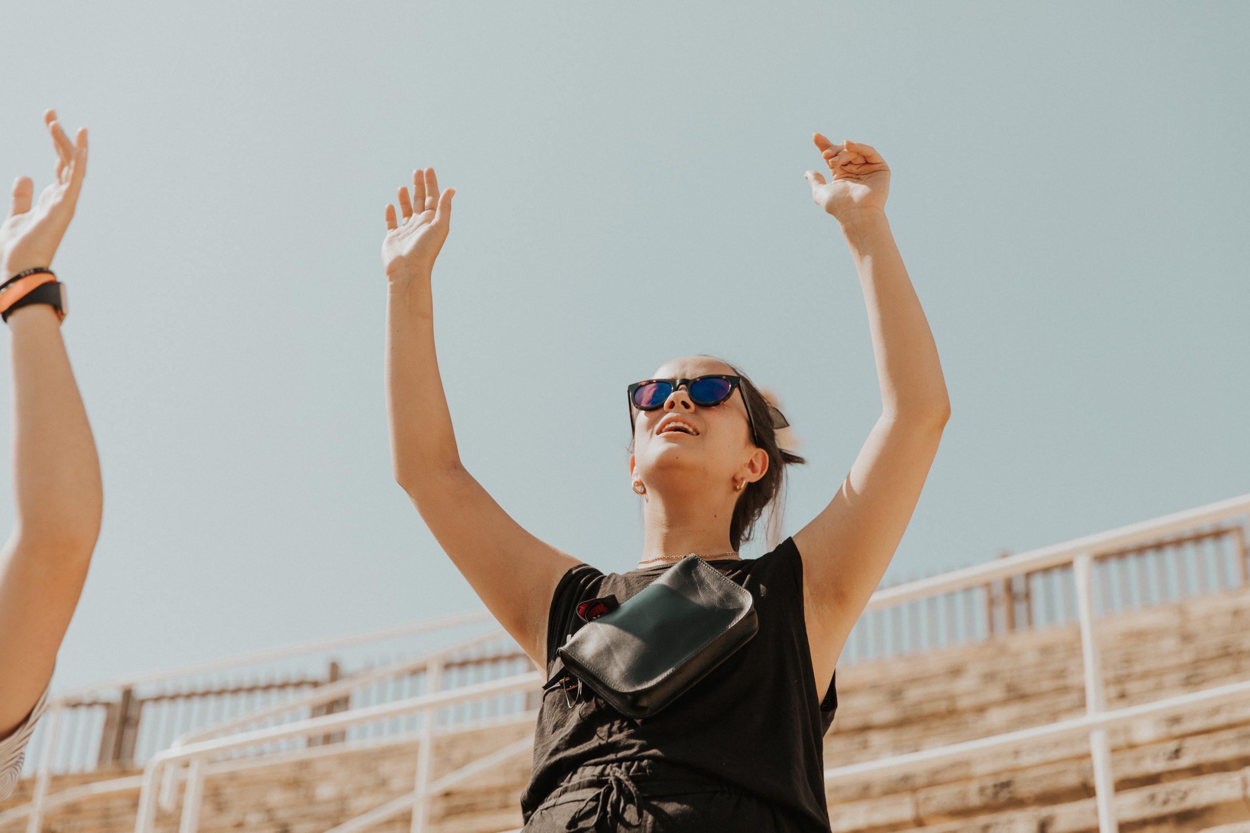 woman worshipping in caesarea
