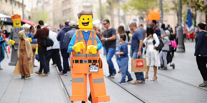 lego man in the middle of the street in Jerusalem
