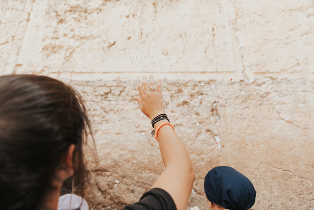 women saying blessings at the western wall