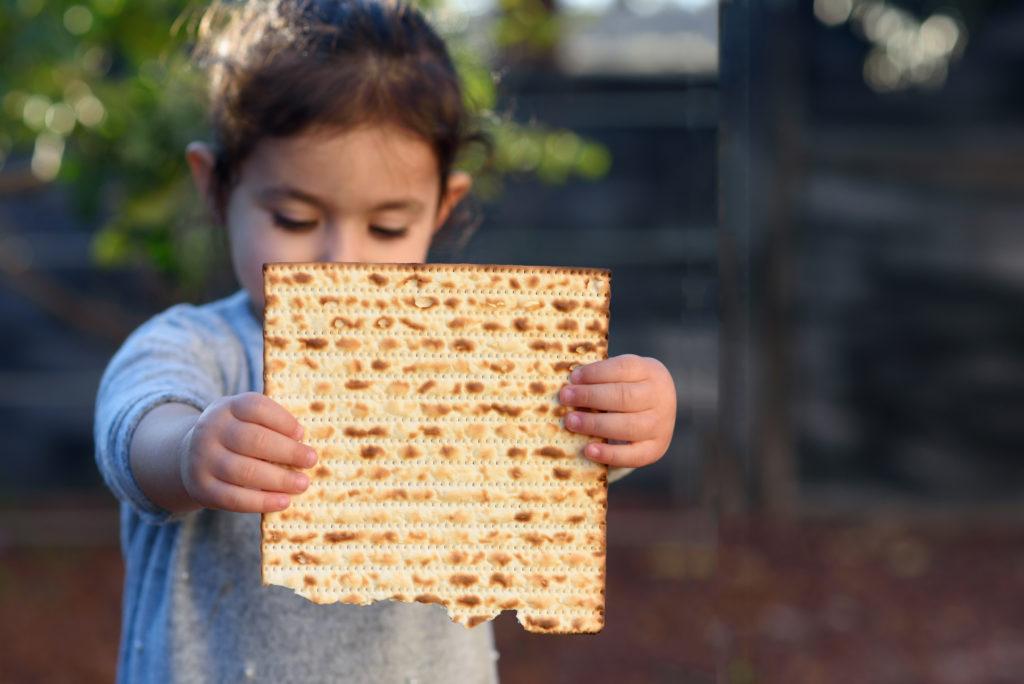 girl holding matzah