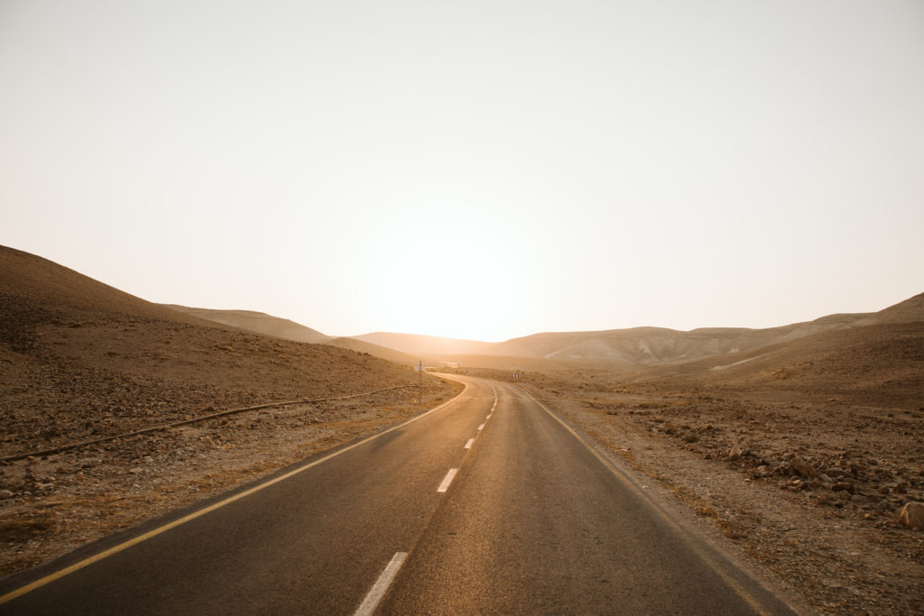 a road at sunset in the negev