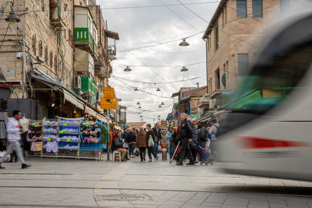 a busy market street in the middle of jerusalem